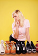 Attractive blonde choosing shoes