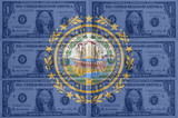 US state of new hampshire flag with transparent dollar banknotes
