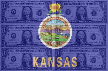 US state of kansas flag with transparent dollar banknotes in bac