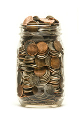Glass jar overflowing with American coins