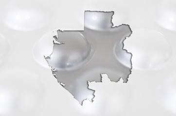 Outline map of gabon with pills in the background for health and