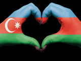 Heart and love gesture by hands colored in azerbaijan flag for t