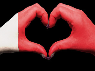 Heart and love gesture by hands colored in bahrain flag  for tou