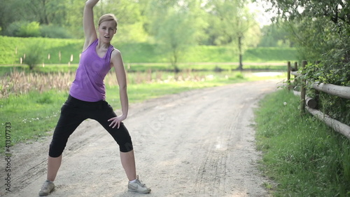 Woman in a fitness outfit experiencing backache after exercise