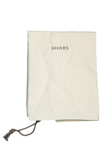 White cotton bag on white isolated background.