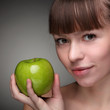 Beauty girl with green apple