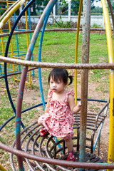 Asian Little girl playing in Playground