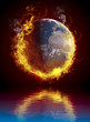 A global warming concept. Planet Earth burning over water reflec
