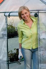 Gardening - woman working in greenhouse