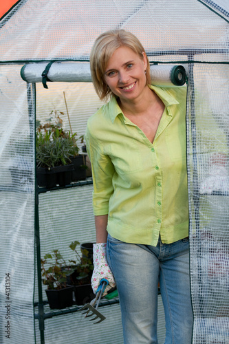 Gardening - woman working in greenhouse