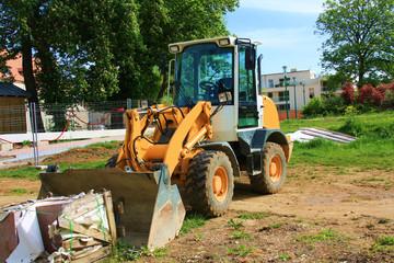 Pelle à pneus, tracto-pelle, travaux dans la terre creuser