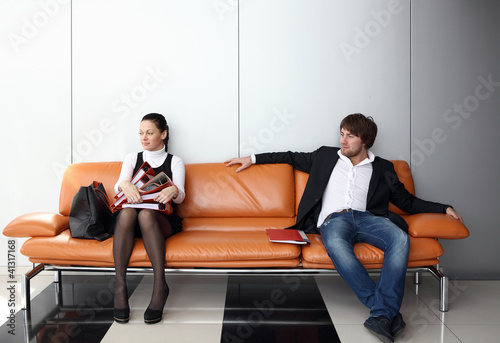 Two business people waiting for job interview