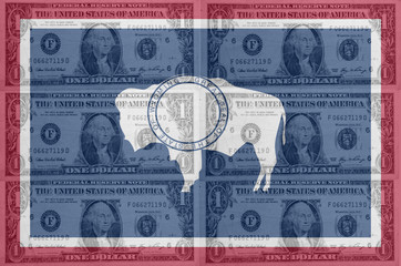 US state of wyoming flag with transparent dollar banknotes in ba
