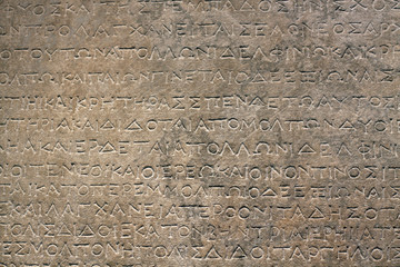 Ancient Greek Inscription on Stone Wall