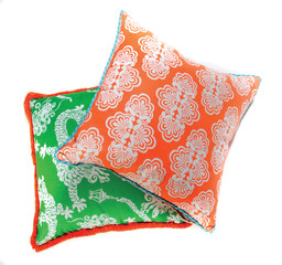 Green and orange throw pillows on white background