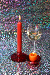 Glass of wine and candles