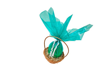 Chocolate Easter Eggs into a basket from corner