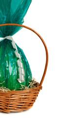 Green cellophane Easter egg in a basket