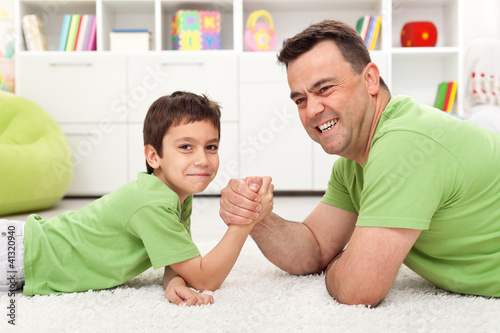 Father and son playing arm wrestling