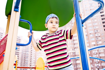 Young boy in bandana on playground