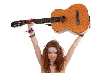woman in hippie outfit holding guitar under her head