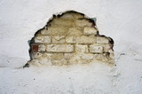 old brick wall with a gap and cracks