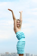 Young blond woman in sexy dress on background of the sky