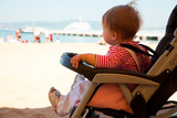 baby in the stroller  on  beach resort