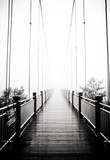 Fototapety view on pedestrian wooden bridge in mist