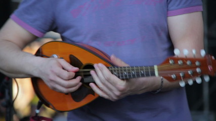 Playing the mandolin