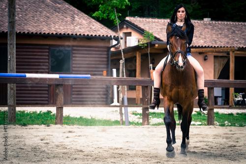 Beauty riding a horse
