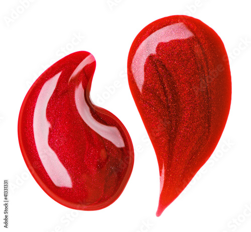 Red nail polish (enamel) drops sample, isolated on white