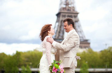 Wedding in Paris. Happy just married couple hugging near the Eif