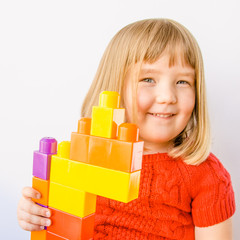 Close up of happy little playing with blocks