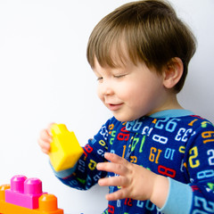 Close up of cute baby boy playing with blocks