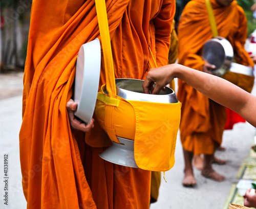 Offer food to monk on early morning