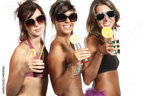 Three sexy girls on white background