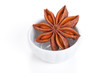 Anise star (Illicium verum)  in a white bowl on white background