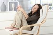Woman relaxing in armchair