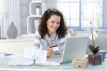 Smiling woman paying online