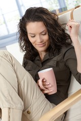 Woman daydreaming with cup of tea
