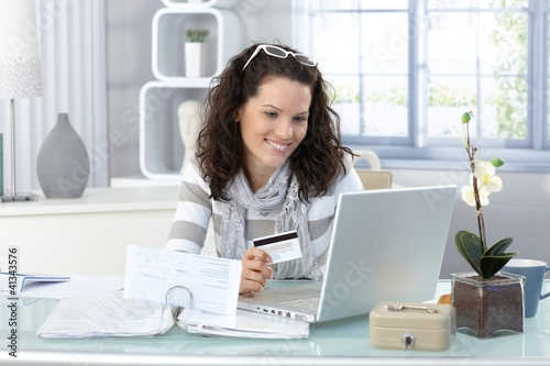 Smiling woman paying online
