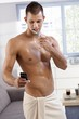 Sexy man in towel using phone