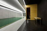 modern concrete house , indoor pool with sauna