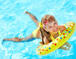 Child playing in swimming pool.