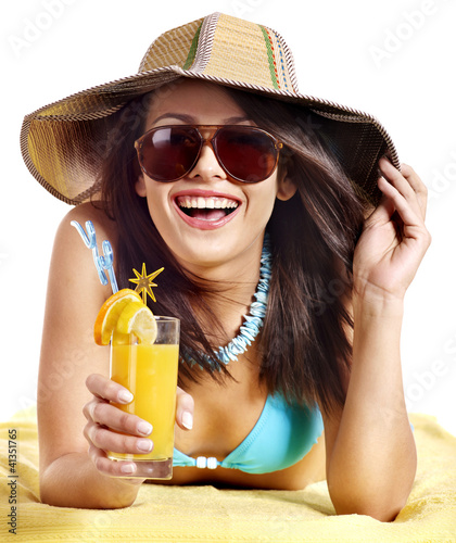Woman on beach drinking cocktail.