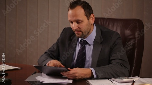 Businessman working with the tablet in the office