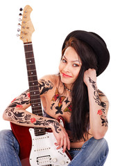 Girl with tattoo playing guitar.