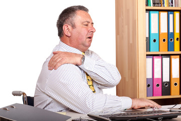 Man in office with shoulder pain