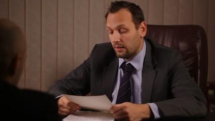 Boss communicate bad news to male worker